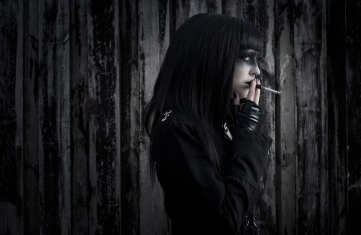 Danish Goth model having a smoke break, two flash lights mixed with available light